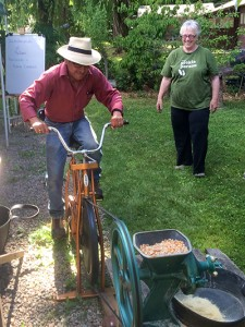 Alejandro grinding grain on the bike.