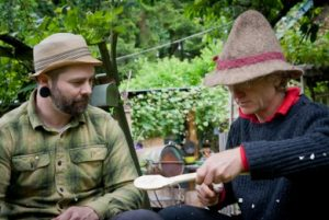 instructor with student in spoon carving class