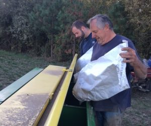 Lyle Spiesschaert, farmer in Gaston, loads his hopper as the first trial run for the rye and red fife seed is planted.