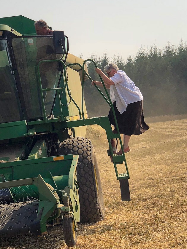 Charlene and Lyle on combine.